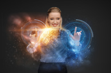 business, future technology and augmented reality concept - businesswoman with virtual planet and space hologram