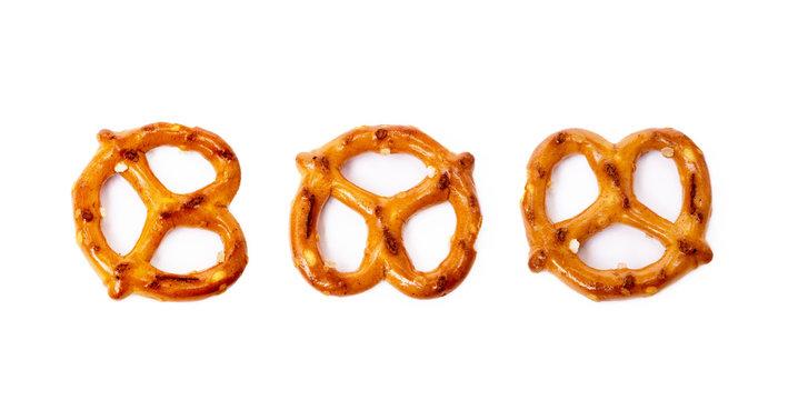 Salty cracker pretzel isolated on white background