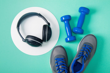 Sport flat lay composition with dumbbells and headphones