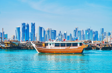 Old boats and modern buildings in Doha, Qatar