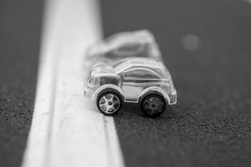 black and white transparent plastic toy cars on starting line