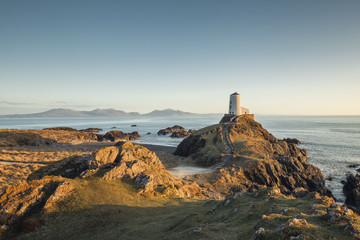 Photo sur Toile Cote Victorian Lighthouse of Llanddwyn Island in Warm Sunset Light