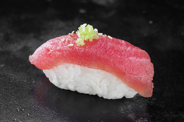 Sushi nigiri with tuna on black background