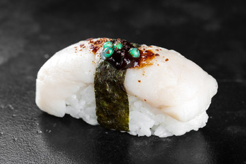 Sushi nigiri with squid on black background