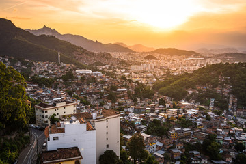 Fototapete - Aerial View of Rio de Janeiro Poor Areas and Slums on Hills by Sunset