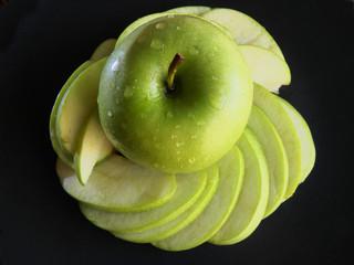 Green apple, green apple still life on a black background