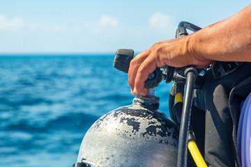Foto op Canvas Duiken Scuba Diver Hand on Tank Closeup
