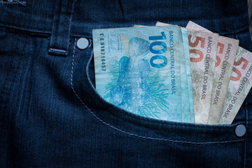 Brazilian bank notes in the jeans pocket