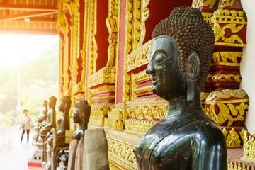Close up of bronze Buddha statue in Laos