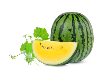 whole and slice yellow watermelon with green leaf isolated on white background