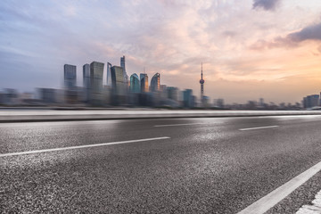 cityscape and skyline of shanghai from empty asphalt road.