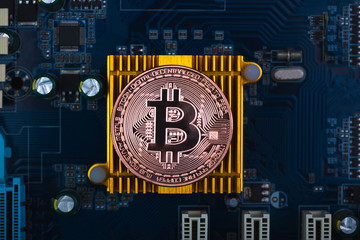 Bitcoin digital currency,  bit-coin on motherboard or electronic board with chips, Cryptocurrency money concept