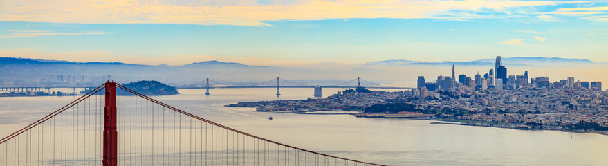 Panorama of the Golden Gate bridge with San Francisco skyline in the background