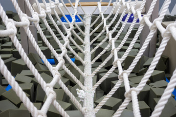 Indoor walk bridge with side rope protection on handrails