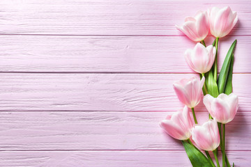 Beautiful composition with tulips for Mother's Day on wooden background