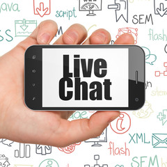 Web development concept: Hand Holding Smartphone with  black text Live Chat on display,  Hand Drawn Site Development Icons background, 3D rendering