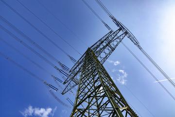 electric pylon under blue sky