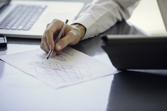 Man working with blueprints