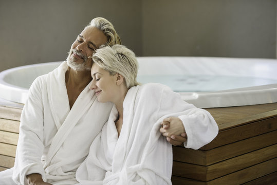 Couple in bathrobes relaxing at spa
