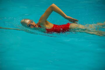 Woman sitting in pool