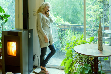 Mature woman talking on cell phone at home