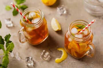 Iced tea with lemon and ice cubes