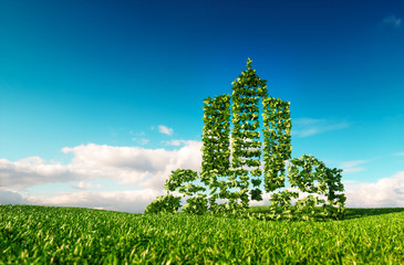 Eco friendly city concept. 3d rendering of city shape sign on fresh spring meadow with blue sky in background.