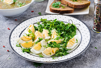 Boiled eggs with greens. Healthy food. Summer salad