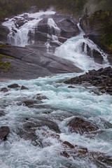 Stunning waterfall on the mountain river in Husedalen valley in Hardangervidda national park, Norway
