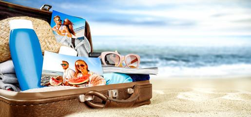 summer suitcase on beach