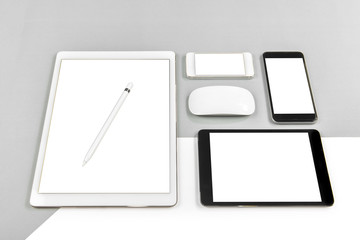 Office table with digital tablet, smartphone, mouse and pencil on isolated pure white background / Laptop and tablet mockup concept. (Monitor clipping path)(Selective Focus)