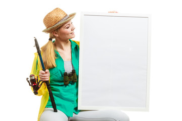 Happy woman with fishing rod holding board