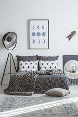 Patterned grey bedroom interior