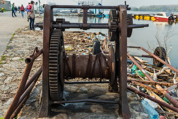 Belgrade, Serbia April 07, 2018: The Danube Coast in Zemun. Ship pulling machine and what remains on the shore when the water withdraws.