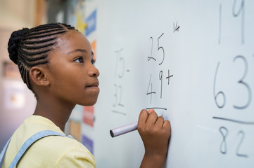 Girl solving mathematical addition