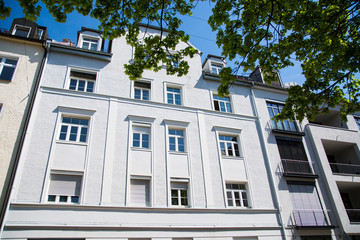 Residential houses in Munich, beautiful residential area, blue sky