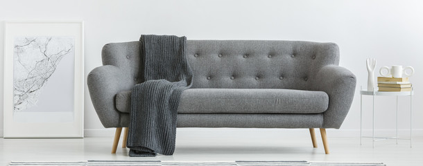 Grey couch with blanket