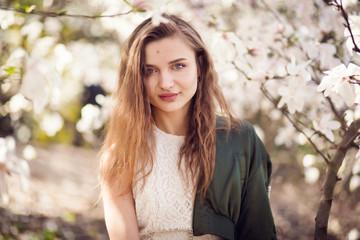 girl posing in magnolia garden