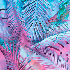 Wall Mural - Tropical and palm leaves in vibrant bold gradient holographic neon  colors. Concept art. Minimal surrealism background.