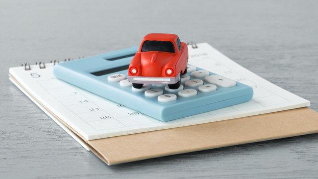 Toy car on caculator and calendar