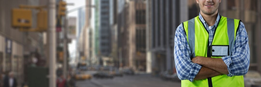 Composite image of smiling construction worker