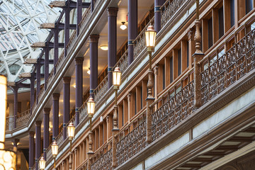 Lampposts lining a balcony in the Old Arcade in Downtown Cleveland. Given National Historic Landmark status in 1975, the Arcade is of Victorian architectural.