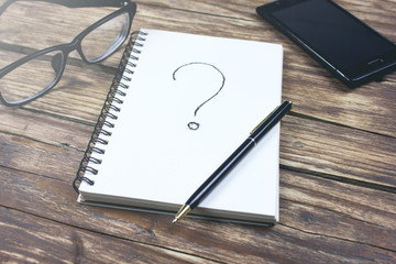Question Mark concept with notebook