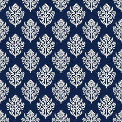 Indigo dye woodblock printed seamless ethnic floral all over pattern. Traditional oriental ornament of India, lily flowers of Kashmir, ecru on navy blue background. Textile design.