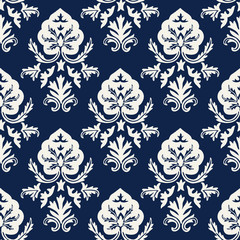 Indigo dye woodblock printed seamless ethnic damask pattern. Traditional oriental ornament of  Kashmir India, stylized acanthus leaves, ecru on navy blue background. Textile design.