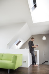 Businessman using tablet at home