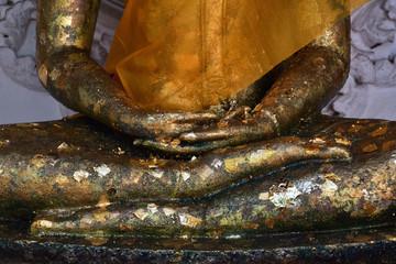 gold leaf on buddha statue
