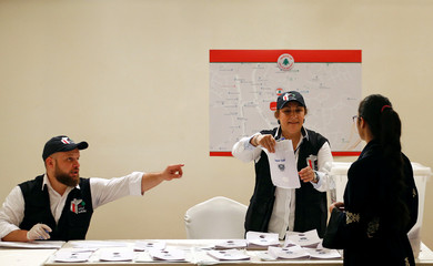 A Lebanese expat casts her vote at the Lebanese Embassy in Riyadh