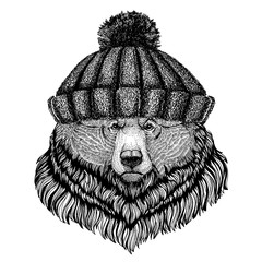 Grizzly bear Big wild bear Cool animal wearing knitted winter hat. Warm headdress beanie Christmas cap for tattoo, t-shirt, emblem, badge, logo, patch