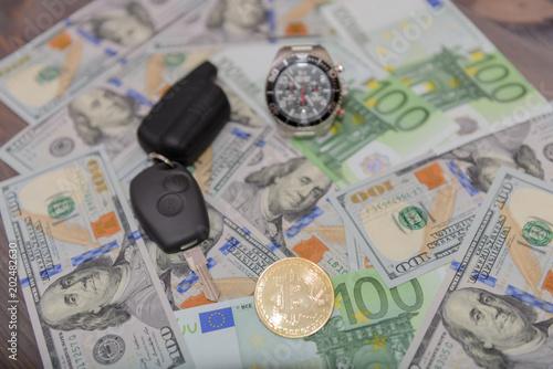 Car Key Chronograph And Gold Bitcoin On Euro And Dollars Banknotes